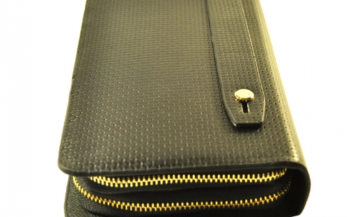 Точечный кожаный мужский клатч марки Vorpe